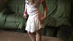 Petite nubile Kitten flashing her panties in a tiny miniskirt