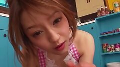 Japanese cutie gives a blow-job in the kitchen